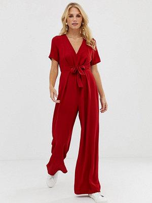 ASOS DESIGN V-ringad minimalistisk jumpsuit med knytning fram