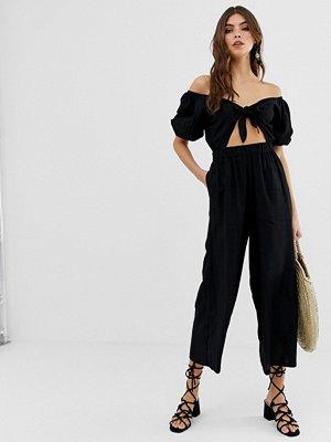 ASOS DESIGN Tea-jumpsuit med puffärm och knytdetalj Svart