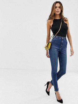 ASOS DESIGN Ridley Blå skinny jeans med hög midja och hälla-detalj