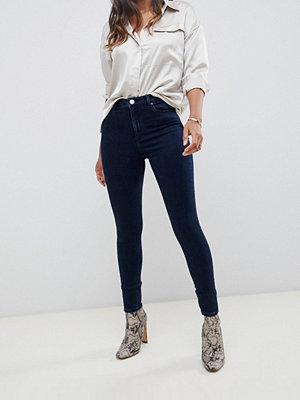 ASOS DESIGN Ridley Mörkblå jeans med hög midja och extra smal passform Mörkblå