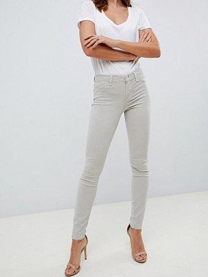 J Brand 485 Mellanhöga super skinny jeans Biscuit