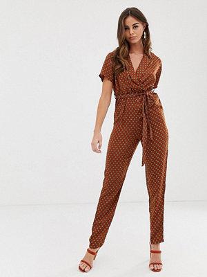 PrettyLittleThing Roströd jumpsuit med geometriskt mönster Rostfärgat