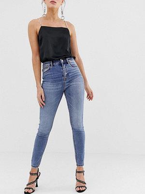 Stradivarius Ljusblå jeans med superhög midja och smal passform
