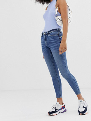 River Island Molly Mellanblå skinny jeans Mid auth