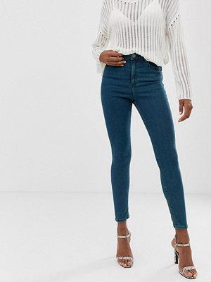 ASOS DESIGN Ridley Gröna skinny jeans med hög midja Grönblå