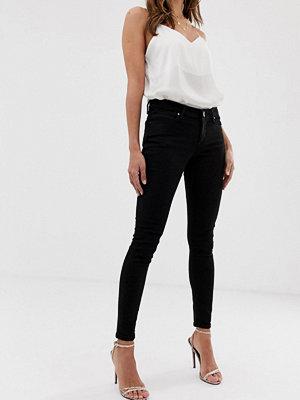 ASOS DESIGN Whitby Svarta skinny jeans med låg midja Rensvarta
