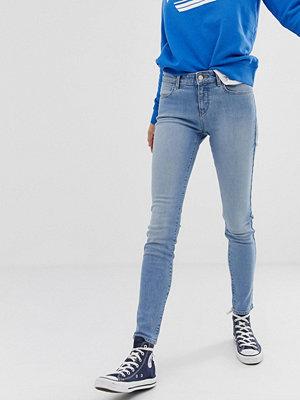 Wrangler Skinny jeans med medelhög midja Blue light