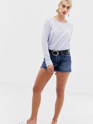 Selected Stella — jeansshorts med råsskuren fåll Mörkblå denim