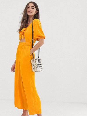 Asos Tall Jumpsuit med puffärm och knytdetalj Daisy yellow