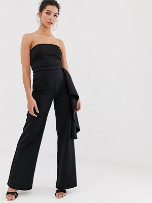 True Violet Exclusive Svart jumpsuit med peplumfåll i sidan