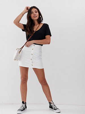 Parisian Minikjol med spräckliga knappar