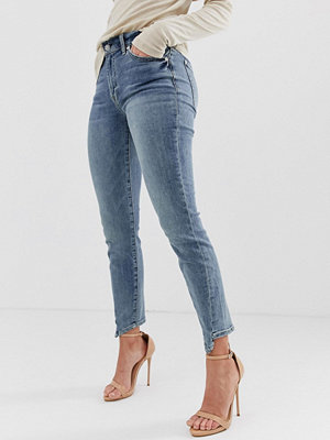 7 For All Mankind Ankellånga skinny jeans med asymmetriskt skuren fåll Bair authentic fort