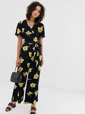 Warehouse Svart jumpsuit med knytning i midjan och gult blommönster