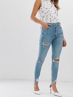 Bershka Blå slitna jean i superskinny