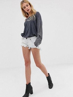 One Teaspoon Bonita shorts med låg midja och fransig fåll Xanthe