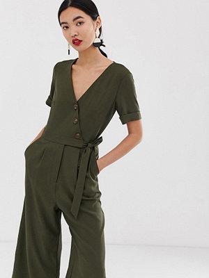 Warehouse Jumpsuit med asymmetrisk knapp i khaki