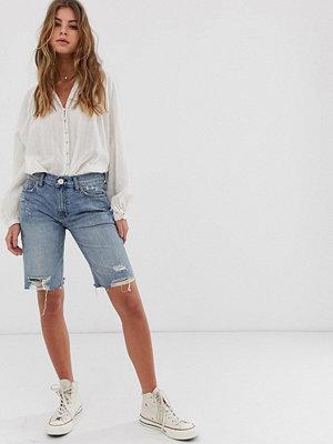 Free People Caroline Slitna jeansshorts i lång modell Tvättad denim