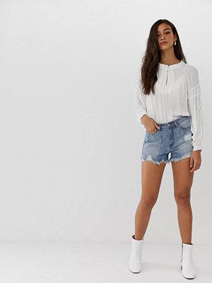 Current Air Slitna jeansshorts med råkant Blå tvätt