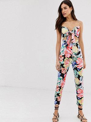 Jumpsuits & playsuits - ASOS DESIGN Blommig jumpsuit med smala axelband och knut framtill Blommigt