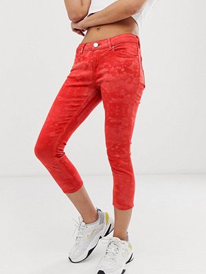 ASOS DESIGN Whitby Orange skinny jeans med låg midja och batikmönster