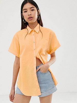 ASOS DESIGN Kortärmad skjorta med upprullad ärm Persika
