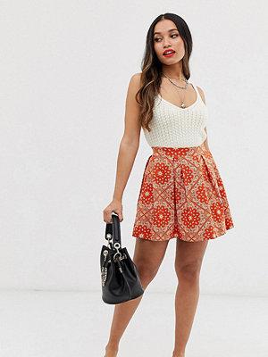 ASOS Petite Orange scarfmönstrad minikjol med lagda veck Orange scarf print
