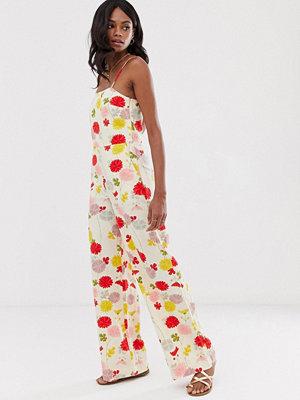 Mango Blommig jumpsuit med smala axelband