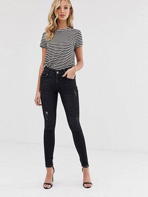 Vero Moda Skinny jeans med slitna partier Svart