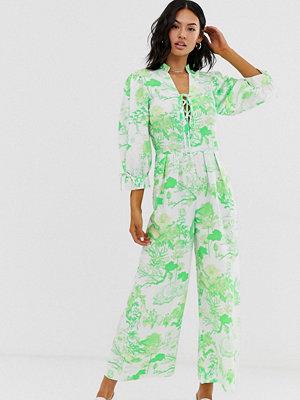 ASOS DESIGN Mönstrad jumpsuit med snörning och puffärmar Grönt mönster