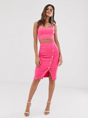 Vesper Rosa pennkjol i midimodell med omlott och knappar Fuschia