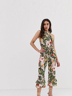 Boohoo Tropiskt mönstrad jumpsuit med halterneck och culotte-byxor