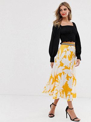 Twisted Wunder Orange plisserad kjol med blommor Orangeblommig