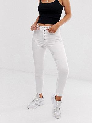 Stradivarius Vita jeans med extra hög midja och knappar