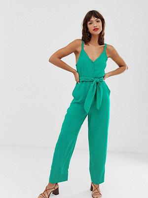 & Other Stories Grön jumpsuit med uddkant och skärp