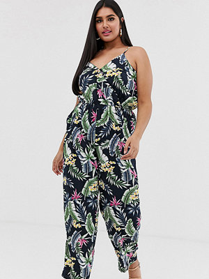Yumi Plus Tropiskt mönstrad jumpsuit med smala axlar Svart