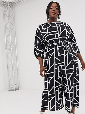 ASOS Curve Svartvit jumpsuit med knytning i midjan och geometriskt mönster Svartvitt geometriskt mönster