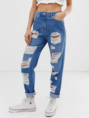 Parisian Jeans med hög midja och extremt slitna detaljer Mellanblå