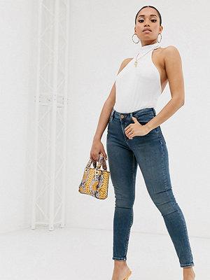 ASOS Petite Ridley Mörkblå stentvättade skinny jeans med hög midja