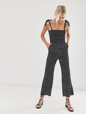 & Other Stories Svart småprickig jumpsuit med knytband på axlarna Dots non-print