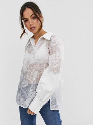Ghospell Mesh-skjorta i oversize med broderade blommor