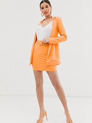 Missguided Orange figursydd minikjol med skärp
