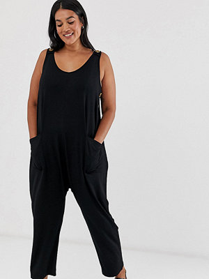 ASOS Curve Minimalistisk jumpsuit med fickor och knappar i sidan