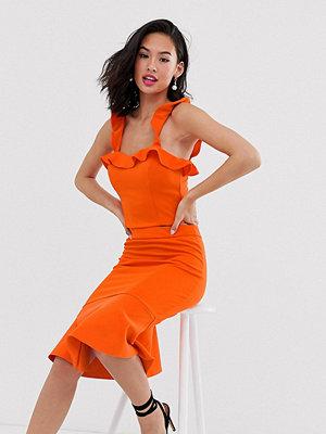 Laced In Love Orange pennkjol av scubatyg med volangfåll