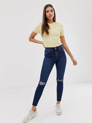 Jeans - New Look Mellanblå skinny jeans med revor på knäna som lyfter och formar Mellanblå