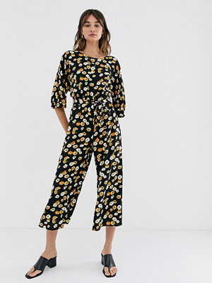 ASOS DESIGN Gul jumpsuit med småblommigt mönster och knytning i midjan Svart-/gulblommig