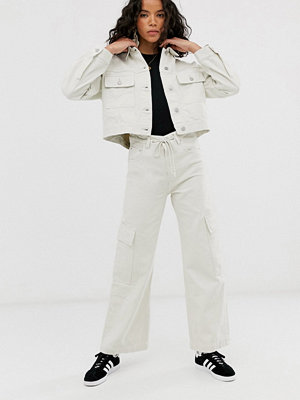 Weekday Gräddvita jeans med dragsko