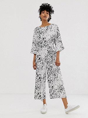 ASOS DESIGN Svartvit jumpsuit med knytning i midjan och abstrakt prickmönster Abstrakt prickmönster