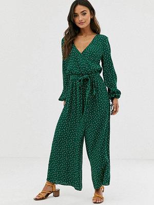 ASOS DESIGN Grön prickig jumpsuit med omlott framtill Grön/vit
