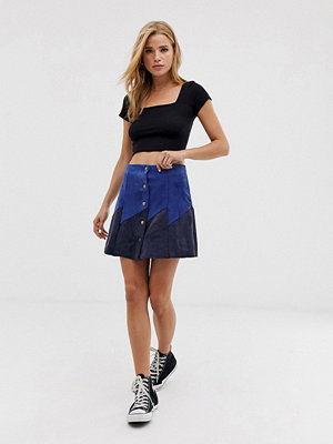 Glamorous Blå och marinblå minikjol i mockaimitation med knappar Blue navy