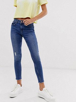 Pieces Skinny jeans med råskuren fåll Mellanblå denim